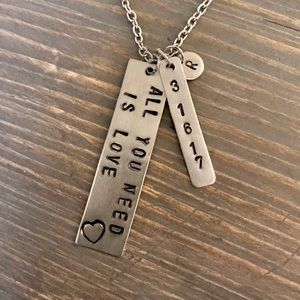 Hand stamped custom All You Need Is Love necklace